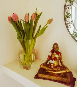 Brahmani's puja at home with a murti of Bhagavan Nityananda